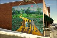 A mural of the yellow brick road from Wizard Of Oz on a brick building (thumbnail)
